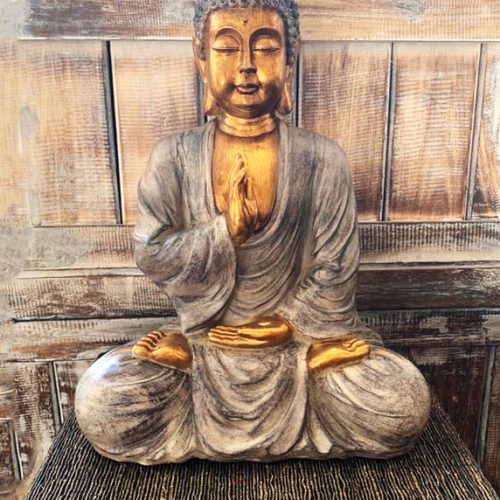 Buddha Statue Sitting meditating Silver and Gold color at Gaia Center in Cyprus.