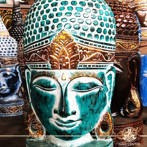 Buddha Statue Face in turquoise and gold colors. Spiritual items at Gaia Center in Cyprus. Cyprus and International Shipping.