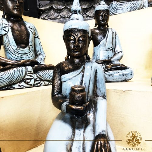 Buddha Statue sitting in creamy grey antique color. Spiritual items at Gaia Center in Cyprus. Cyprus and International Shipping.