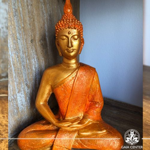 Buddha Statue sitting gold and orange color. Spiritual items at Gaia Center in Cyprus. Cyprus and International Shipping.