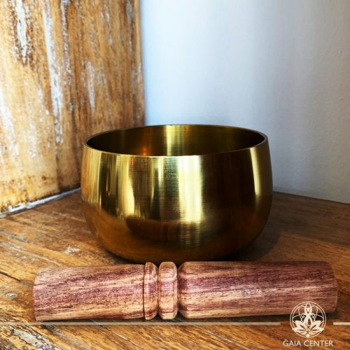 Singing Bowl Tibetan brass with a wooden stick at Gaia Center in Cyprus. Cyprus and International shipping.