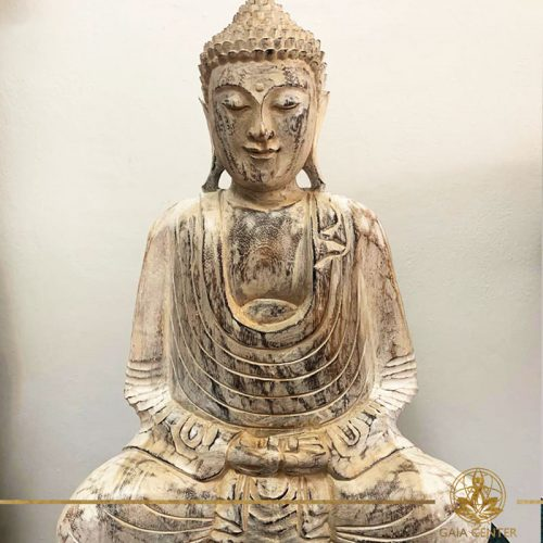 Buddha Statue wooden hand carved white wash and gold colors. Decore and spiritual items at Gaia Center in Cyprus. Shop online at https://gaia-center.com. Cyprus and Worldwide shipping.