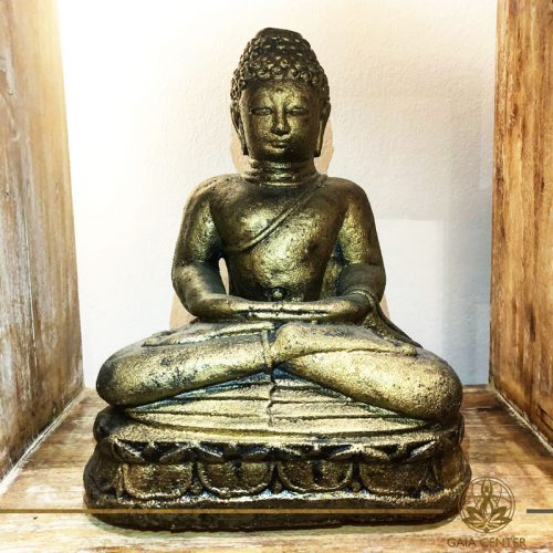 Buddha Statue Meditating - stone with antique gold color finishing. Spiritual items at Gaia Center in Cyprus. Order online: https://www.gaia-center.com Cyprus and International Shipping.