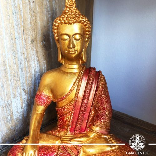 Buddha Statue antique gold and red color finishing. Spiritual items at Gaia Center in Cyprus. Order online: https://www.gaia-center.com Cyprus and International Shipping.