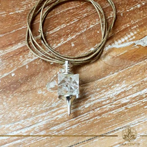 Clear crystal quartz merkaba star pendant on a string. Crystal and Gemstone pendants at Gaia Center in Cyprus. Worldwide delivery, shop online: https://gaia-center.com