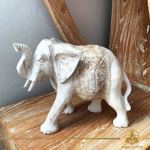 Elephant statue wooden hand carved white wash and gold colors. Decore and spiritual items at Gaia Center in Cyprus. Shop online at https://gaia-center.com. Cyprus and Worldwide shipping.