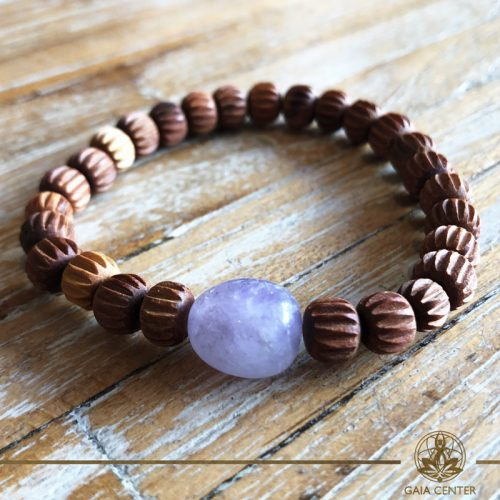 Bracelet Amethyst and Sandalwood at Gaia-Center Cyprus. Gemstone and Crystal selection. Shop online at: https://www.gaia-center.com. Cyprus and Worldwide shipping.