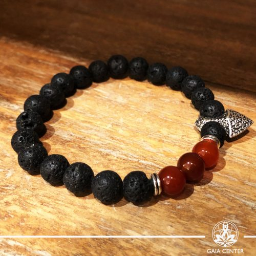 Bracelet Carnelian and Lava Stone with metal charm at Gaia-Center Cyprus. Gemstone and Crystal selection. Shop online at: https://www.gaia-center.com. Cyprus and Worldwide shipping.