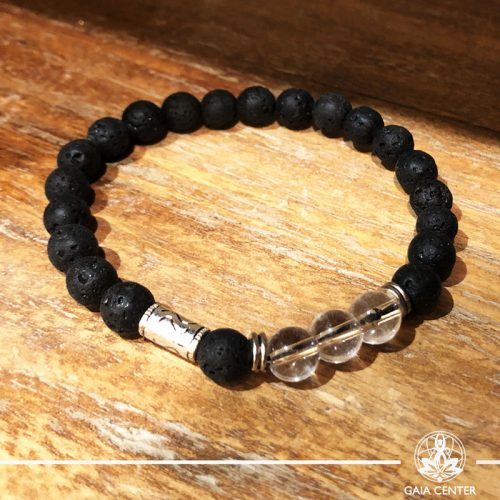 Bracelet Crystal Quartz and Lava Stone with metal charm at Gaia-Center Cyprus. Gemstone and Crystal selection. Shop online at: https://www.gaia-center.com. Cyprus and Worldwide shipping.