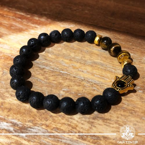 Bracelet Tigers Eye and Lava Stone with metal Hamsa charm at Gaia-Center Cyprus. Gemstone and Crystal selection. Shop online at: https://www.gaia-center.com. Cyprus and Worldwide shipping.