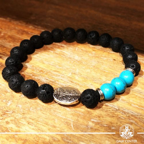 Bracelet Turquoise and Lava Stone with metal charm at Gaia-Center Cyprus. Gemstone and Crystal selection. Shop online at: https://www.gaia-center.com. Cyprus and Worldwide shipping.