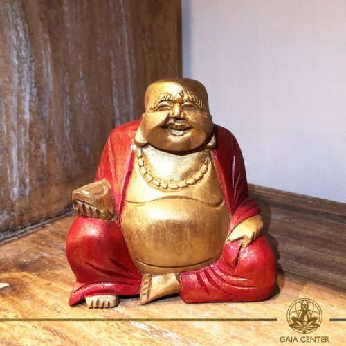 Happy Buddha Statue wooden hand carved - antique gold and red color finishing. Spiritual items at Gaia Center in Cyprus. Order online: https://www.gaia-center.com Cyprus and International Shipping.
