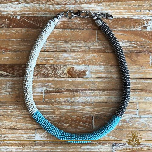 Summer necklace - ring design necklace made from beads cream color, turquoise and silver color. Summer essential jewellery at Gaia Center in Cyprus. Shop online at https://gaia-center.com. Cyprus and Worldwide shipping.