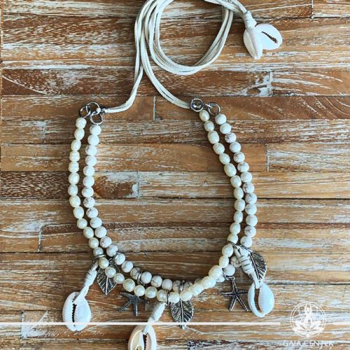 Summer necklace - white stone and white pearls imitation design with sea shells charms on a string. Summer essential jewellery at Gaia Center in Cyprus. Shop online at https://gaia-center.com. Cyprus and Worldwide shipping.