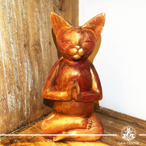 Yoga Cat Meditating Statue - wooded hand carved with antique gold and red color finishing. Spiritual items at Gaia Center in Cyprus. Order online: https://www.gaia-center.com Cyprus and International Shipping.