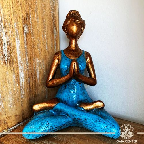 Yoga Lady Meditating Statue - Lotus pose and Hands in Namaste- casted lava sand with antique gold and blue color finishing. Spiritual items at Gaia Center in Cyprus. Order online: https://www.gaia-center.com Cyprus and International Shipping.