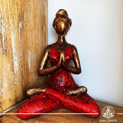 Yoga Lady Meditating Statue - Lotus pose and Hands in Namaste- casted lava sand with antique gold and red color finishing. Spiritual items at Gaia Center in Cyprus. Order online: https://www.gaia-center.com Cyprus and International Shipping.