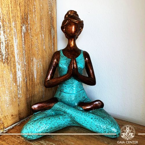 Yoga Lady Meditating Statue - Lotus pose and Hands in Namaste- casted lava sand with antique copper and turquoise color finishing. Spiritual items at Gaia Center in Cyprus. Order online: https://www.gaia-center.com Cyprus and International Shipping.