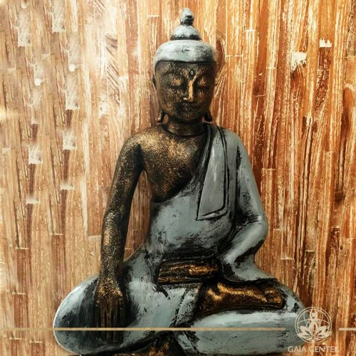 Buddha Statue grey and antique gold finishing sitting and meditating with hands gesturing Samadhi or Yoga Mudra at Gaia Center in Cyprus. Shop online at https://gaia-center.com. Cyprus and Worldwide shipping.