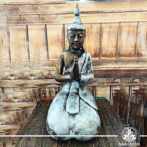 Buddha Statue grey and antique gold finishing sitting and meditating with hands gesturing NAMASTE at Gaia Center in Cyprus. Shop online at https://gaia-center.com. Cyprus and Worldwide shipping.
