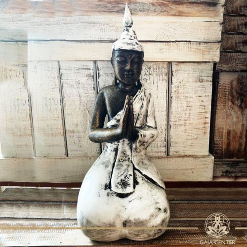 Buddha Statue white and antique gold finishing sitting and meditating with hands gesturing Namaste at Gaia Center in Cyprus. Shop online at https://gaia-center.com. Cyprus and Worldwide shipping.