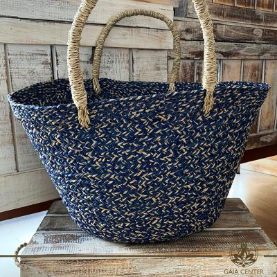 Natural blue color straw bag. Summer essentials jewellery and bags at Gaia Center in Cyprus. Shop online at https://gaia-center.com. Cyprus and Worldwide shipping.