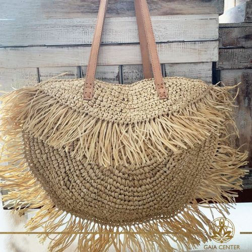 Natural color straw shoulder bag. Summer essentials jewellery and bags at Gaia Center in Cyprus. Shop online at https://gaia-center.com. Cyprus and Worldwide shipping.