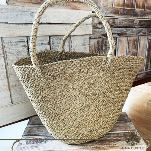 Natural color straw bag. Summer essentials jewellery and bags at Gaia Center in Cyprus. Shop online at https://gaia-center.com. Cyprus and Worldwide shipping.