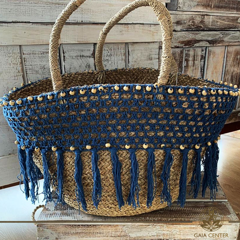 Natural color straw bag blue crochet and strings design. Summer essentials jewellery and bags at Gaia Center in Cyprus. Shop online at https://gaia-center.com. Cyprus and Worldwide shipping.