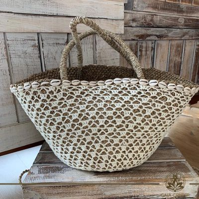 Natural straw bag cream color crochet and sea shells design. Summer essentials jewellery and bags at Gaia Center in Cyprus. Shop online at https://gaia-center.com. Cyprus and Worldwide shipping.