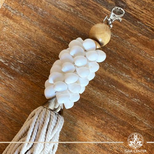 Natural seashell and cotton string key chain-charm at Gaia Center in Cyprus. Shop online at https://gaia-center.com. Cyprus and Worldwide shipping.