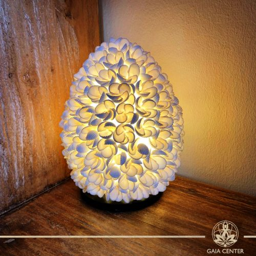 Natural sea shell decor lamp at Gaia Center in Cyprus. Shop online at https://gaia-center.com. Cyprus and Worldwide shipping.