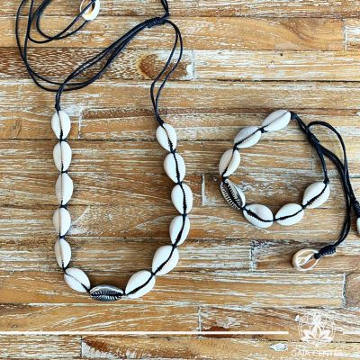 Summer set necklace and bracelet - sea shells on a black color string with silver color charm. Summer essential jewellery at Gaia Center in Cyprus. Shop online at https://gaia-center.com. Cyprus and Worldwide shipping.