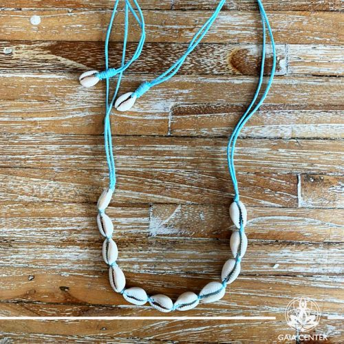 Summer necklace - sea shells on a light blue color string. Summer essential jewellery at Gaia Center in Cyprus. Shop online at https://gaia-center.com. Cyprus and Worldwide shipping.
