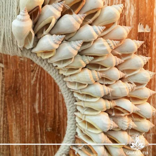 Natural seashell and macrame stand decor at Gaia Center in Cyprus. Shop online at https://gaia-center.com. Cyprus and Worldwide shipping.