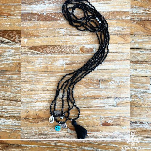 Summer necklace - black color beads sea shell and decor charms. Summer essential jewellery at Gaia Center in Cyprus. Shop online at https://gaia-center.com. Cyprus and Worldwide shipping.