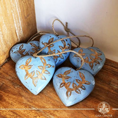 Wooden hand carved hearts on a string blue finishing at Gaia Center in Cyprus. Shop online at https://gaia-center.com. Cyprus and Worldwide shipping.