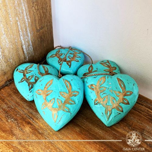 Wooden hand carved hearts on a string turquoise finishing at Gaia Center in Cyprus. Shop online at https://gaia-center.com. Cyprus and Worldwide shipping.
