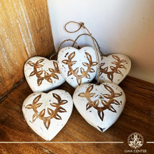 Wooden hand carved hearts on a string white finishing at Gaia Center in Cyprus. Shop online at https://gaia-center.com. Cyprus and Worldwide shipping.
