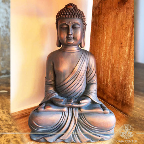 Buddha Statue meditating pose antique blue and copper color finishing at Gaia Center | Cyprus.