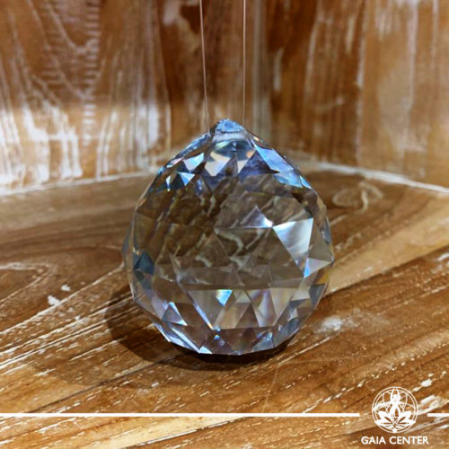 Faceted Crystal Ball sun-catcher handing on a string. Gaia Center   Cyprus.