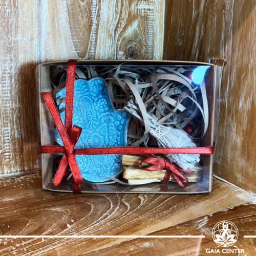 Gifts Sets ideas for Christmas. Spiritual gifts. Set includes Hamsa of fatima hand ceramic tray  bowl for smudging, Californian White Sage smudge stick bundle and two Palo Santo wood sticks. Shop online at Gaia Center   Cyprus: https://www.gaia-center.com We deliver all over Cyprus and Worldwide shipping.