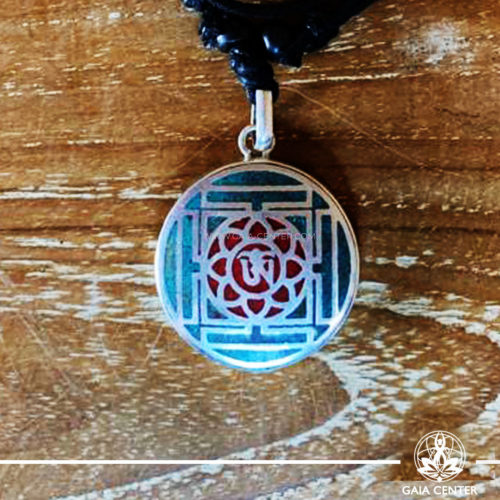 Tibetan Pendant Om symbol in lotus flower and yantra or mandala design. Red coral and turquoise. Adjustable black string. Selection of Tibetan Jewelry made of crystals, gemstones, combination of metals at Gaia Center | Cyprus.