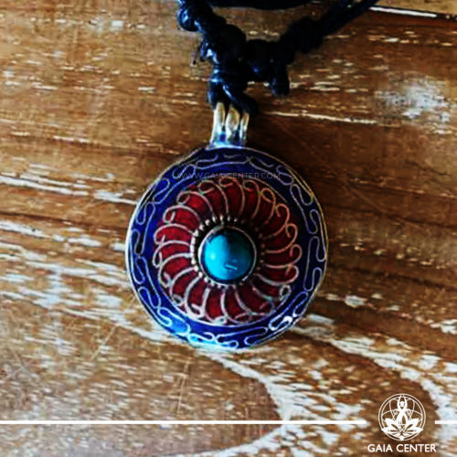Tibetan Pendant Flower symbol design. Red coral, lapis lazuli and turquoise. Adjustable black string. Selection of Tibetan Jewelry made of crystals, gemstones, combination of metals at Gaia Center | Cyprus.