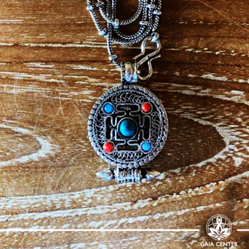 Tibetan Gau box Antique Pendant Kalachakra buddhist symbol. With a metal chain. Tibetan Jewelry made from crystals, semiprecious gemstones, and artistic combination of metals at Gaia Center   Cyprus.