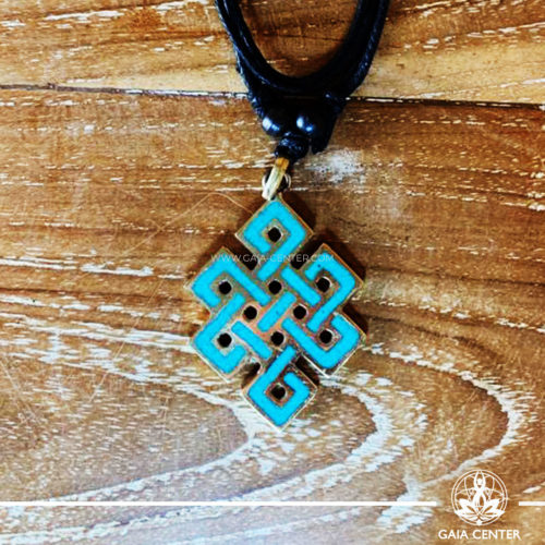 Tibetan Pendant Endless knot buddhist symbol. Metal inlaid with turquoise. Adjustable black string. Selection of Tibetan Jewelry made from crystals, gemstones, combination of metals at Gaia Center   Cyprus.
