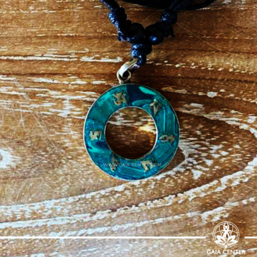 Tibetan Pendant Circle Style design. Made from combination of metals and semiprecious stone. Malachite crushed inlaid with buddhist symbols. Adjustable black cord or string. Selection of Tibetan jewelry at Gaia Center | Cyprus.