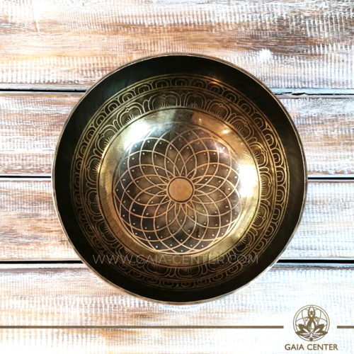 Sining Bowl metal with engraved design of Buddhist Conch Shell Symbol. mandala flower and mantra for Sound Healing Therapy at GAIA CENTER   CYPRUS. Original from Nepal. Cyprus delivery to: Limassol, Paphos, Nicosia, Larnaca, Paralimni, Strovolos. Including provinces and small suburbs. Europe and International Worldwide shipping. Wholesale and Retail. Shop online for Singing Bowls: https://gaia-center.com