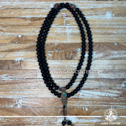 Crystal Malas Selection: Tibetan Prayer Mala from Black Shiva Lingham Stone, Blue Turquoise and tibetan beads design. Crystal and Wooden malas collection Gaia Center | Cyprus.
