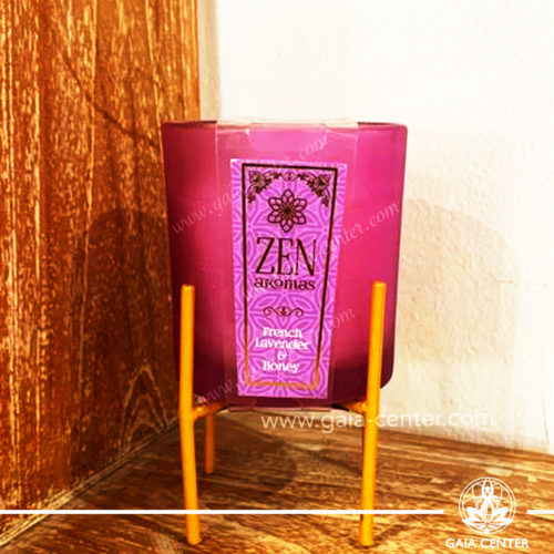 Aroma Scented Candle with Fragrance French Lavender and Honey comes in a vibrant glass holder with a metal stand. At Gaia Center   Cyprus.